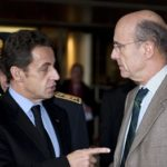 France's President Sarkozy speaks with Mayor of Bordeaux Juppe, after a meeting with local authorities during his visit to the region hit by a storm in the region near Pian-Medoc,